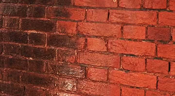 picture of brickwall during sodablating cleaning