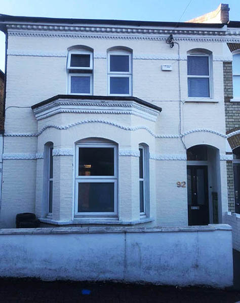 picture of house with painted brickwork before paint removal